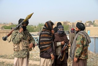 Taliban, Afghan forces battle for control of northern city