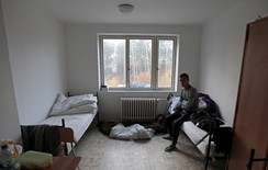 A migrant sits in his room in the facility for detention of foreigners in Bela-Jezova, Czech Republic