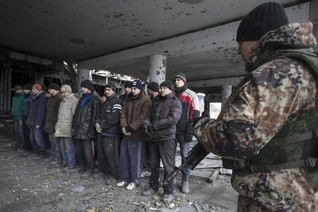Ukrainian prisoners forced to hunt for dead comrades in airport rubble