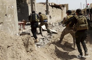 Iraqi forces fight IS militants at gates of Anbar provincial capital