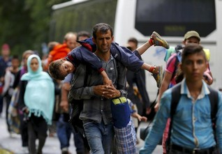 Weary Hungarians polarised by tide of refugees