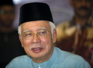 Malaysia's prime minister denies embezzling 1MDB funds