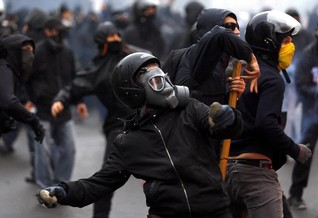 Italian police battle rioters at start of Milan Expo
