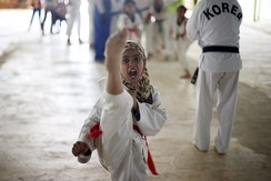 Syrian refugee girls undergo training in the Korean Taekwondo Academy at Al Zaatari