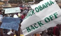 Ugandan president signs anti-gay bill, defying the West