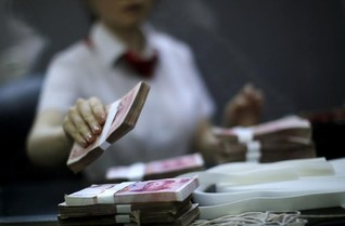China targets overseas fund transfers in graft fight