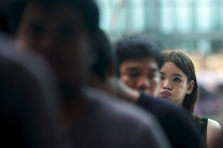 Phiradach, a 21-year-old transgender, queues up during an army draft held at a school in Klong Toey, the dockside slum area in Bangkok, Thailand