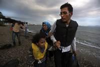 Afghan immigrants land at Greek island of Kos after crossing sea