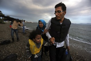 Afghan immigrants land at a beach on the Greek island of Kos after crossing on a dingy a part of the south-eastern Aegean Sea between Turkey and Greece