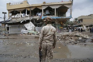 Baghdad car bomb kills 8 people, fighting west of capital