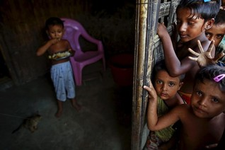Beaten and starving, some Rohingya flee boats, return to  camps