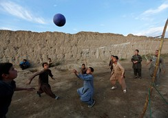 Afghan boys play volleyball on the outskirts of Kabul October 23, 2014