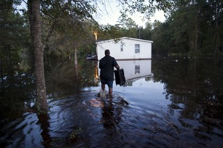 Jeffrey Cokely returns for valuables at his flooded home on Frank Williams Road in Georgetown, South Carolina
