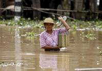 Myanmar leader goes to disaster zones as floods batter countryside