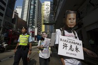 China to put prominent anti-graft activist on trial