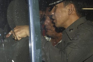 Seven Thai policemen charged as probe into senior officers widens