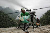 FEATURE–India battles to get aid to flood-hit Himalayas
